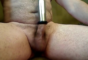 Cow milking gadgetry on male cock