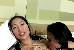 Dancing Asian tranny strips away of black skivvies and jerks